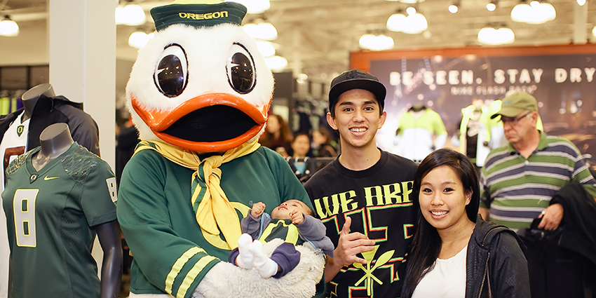A family and the Duck at the UO Alumni event at the Nike story